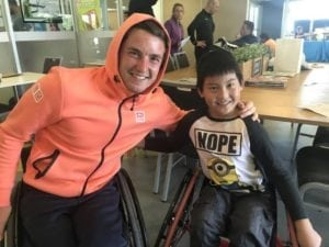 Gin Woodman pictured with World Number 1 player Gordon Reed at the Melbourne Wheelchair Tennis Open
